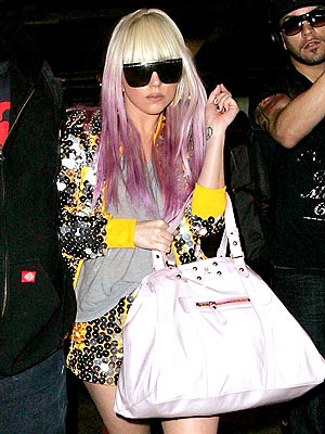 Lady Gaga in London Heathrow Airport with purple locks.