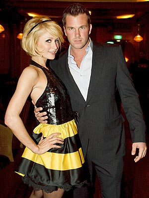 Paris changes her hair from long to bob cuts often. Here she is with hunky boyfriend Doug Reinhart in Amsterdam.