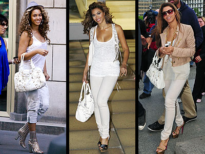 Beyonce's  spectacular jeweled white Valentino bag looks great with skinny jeans.