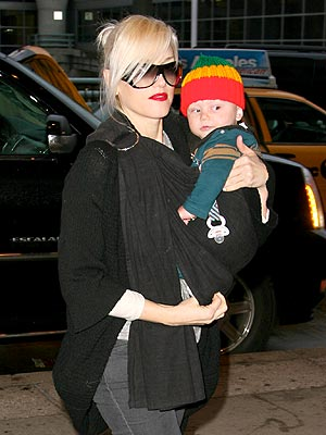 Gwen Stefani and 8 month old son Zuma head into John F. Kennedy Airport in New York.