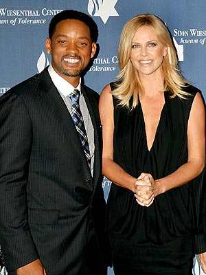 Charlize Theron presented Will Smith with the Simon Weisenthal Center's Humanitarian Award for his commitment to education, cultural diversity and social responsibility.