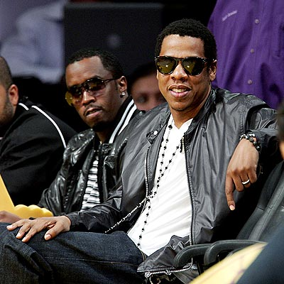 Meanwhile, hubby Jay-Z meets his millionaire buddy Diddy for the Lakers and Rockets game in LA.