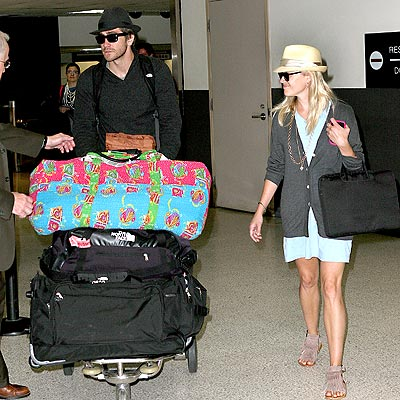 Jake Gyllenhaal and girlfriend Reese Witherspoon arrive back in LA after attending sister Maggie's wedding.