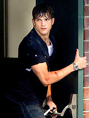 Ashton Kutcher on the set of his new action film Five Killers. In the movie, (also starring Katherine Heigl,) he plays a hit man on the run. Oooh! I'm gonna like this one!