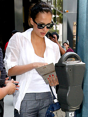 Jessica Alba feeds a meter in Beverly Hills.