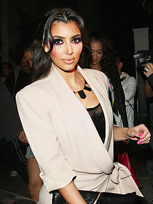 Kim Kardashian at STK's one year anniversary. Earlier that evening, she attended the performance of the last three American Idol contestants with her sister Kourtney and mother.