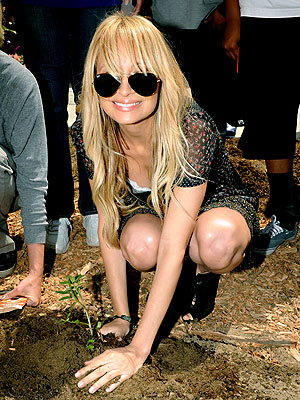 Nicole Richie plants a tree at the Helen Bernstein High School in Hollywood for the launch of the Environmental Media Association's effort to provide organic gardens in LA schools.