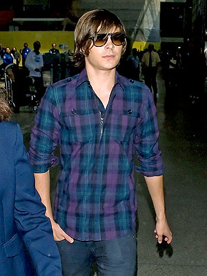 Just finishing touring in Europe, Zac Efron is off again spotted in LAX.