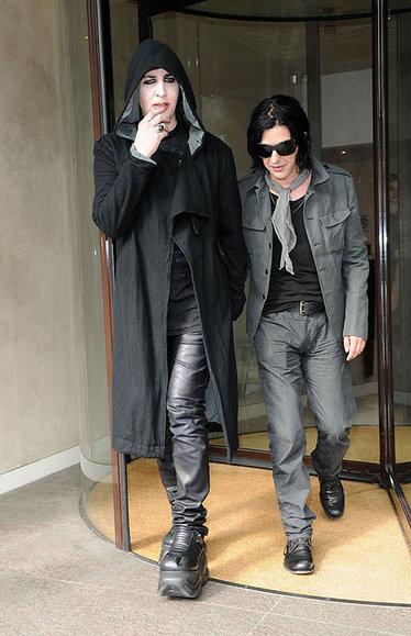 Marilyn Manson and Twiggy Ramirez leave their London hotel room.