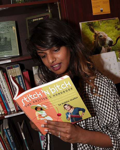 MIA reads a book in Housing Works Bookstore in New York.