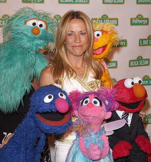 Sheryl Crow joins the Sesame Street cast during a benefit for the Sesame workshop.