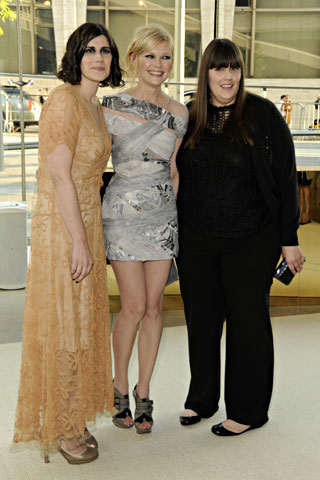 Womenswear Designers of the Year Laura and Kate Mulleavy of Rodarte, with Kirsten Dunst, center, in their design with a Salvatore Ferragamo clutch.