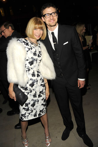 Vogue's Anna Wintour, in Carolina Herrera, with Justin Timberlake.
