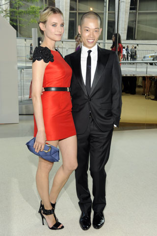 Diane Kruger, in a Jason Wu dress, Tom Binns jewelry, and Roger Vivier bag and shoes, with Jason Wu.