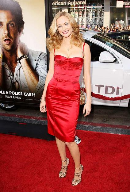 """Heather Graham painted the town crimson red in this Dolce & Gabbana corset dress with $735 """"Flynn"""" Jimmy Choo sandals."""