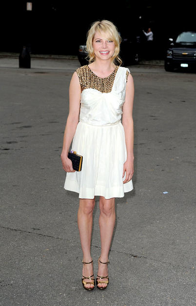 """Michelle Williams (the late Heath Ledger's baby mama) made a rare appearance at the 2009 Fresh Air Fund gala in a stunning ivory 3.1  Phillip Lim dress,  $800 Jimmy Choo """"Mirrored"""" sandals and a Yves St. Laurent clutch."""