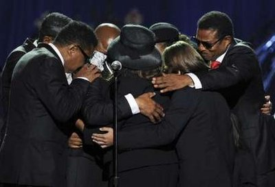 The Jackson Family console Usher as well as each other.