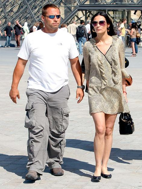 Demi with her bodyguard during a visit to the Louvre in Paris.