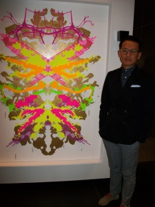 WINNER Hai Nguyen stands next to his piece Rorschach X Dallas Google Earth.