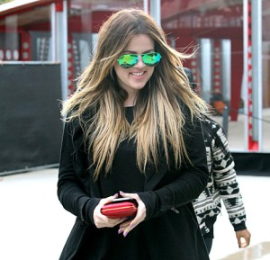 Khloe Kardashian was all smiles on while doing some Christmas shopping in L.A. just one week after filing for divorce from Lamar Odom. We bet she'll be getting her groove back with lots of hot guys. Matt Kemp is just the start.