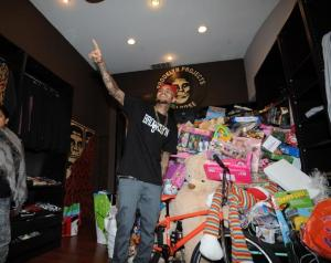 Chris Brown attended Brooklyn Project Store to pose with fans at the charity event for Christmas. The singer was given a 'day pass' from his court ordered rehab  in order to attend.